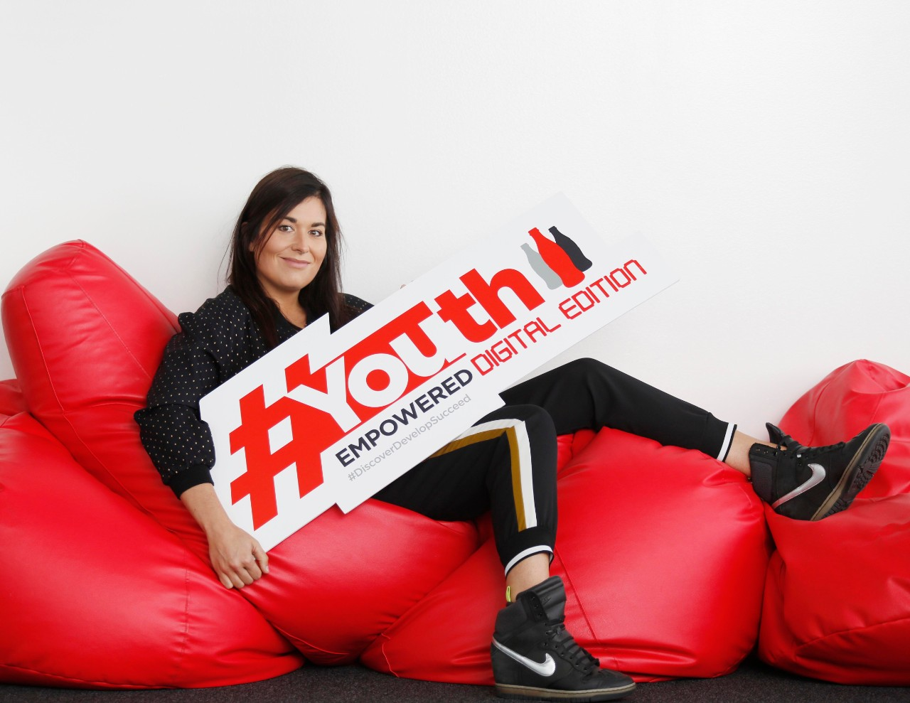 woman-withsign-couch